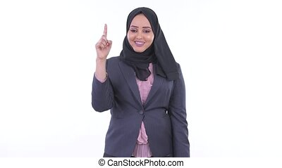 Happy young African Muslim businesswoman pointing up -...