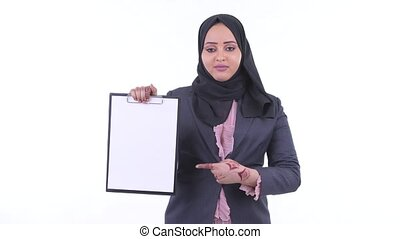 Happy young African Muslim businesswoman showing clipboard...