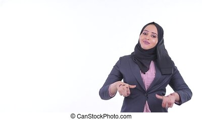 Happy young African Muslim businesswoman thinking and...
