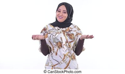 Happy young African Muslim woman being interviewed - Studio...