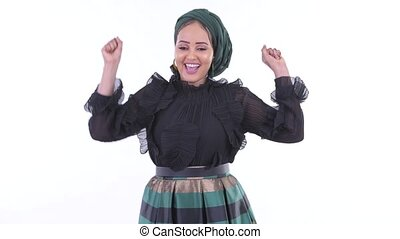 Happy young African Muslim woman getting good news - Studio...