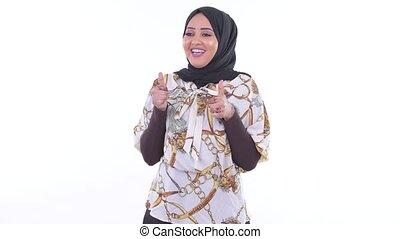 Happy young African Muslim woman giving thumbs up and...