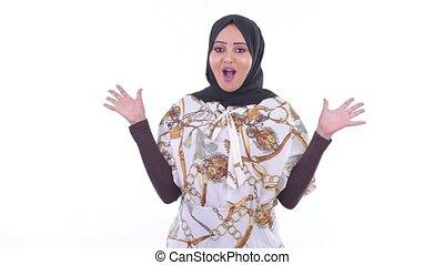 Happy young African Muslim woman looking surprised - Studio...