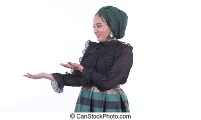 Happy young African Muslim woman presenting something -...