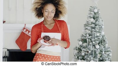 Happy young African woman celebrating Christmas