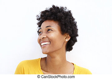Happy young african woman looking away