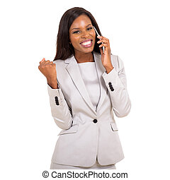 young african woman receiving exciting news