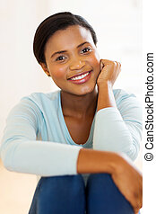 young african woman relaxing at home