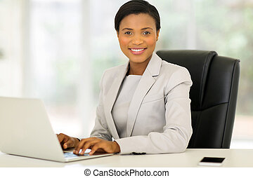 young afro american businesswoman working on laptop