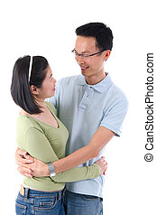 Happy young Asian couple isolated in home background.