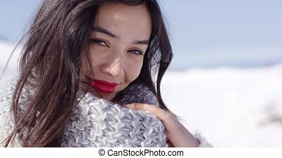 Happy young asian girl enjoys snowy winter