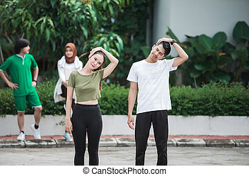 happy young asian people exercise and warm up