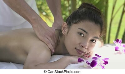 Happy young asian woman in spa