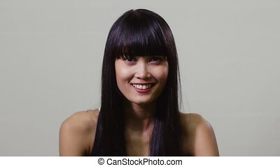 Happy young asian woman smiling