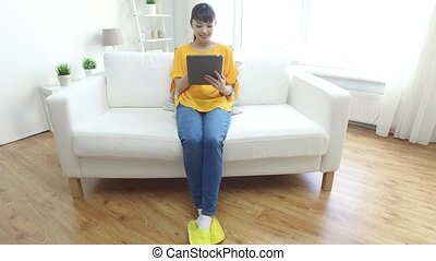 happy young asian woman with tablet
