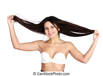 happy young attractive woman holding her hair