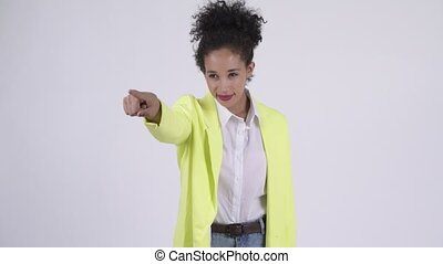 Happy young beautiful African businesswoman pointing finger...