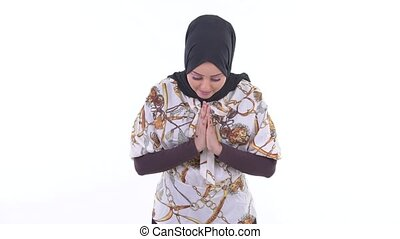 Happy young beautiful African Muslim woman bowing with...