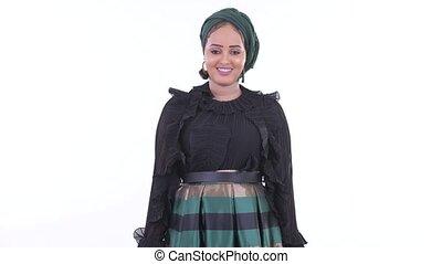 Happy young beautiful African Muslim woman smiling - Studio...