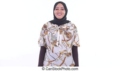 Happy young beautiful African Muslim woman smiling - Studio...