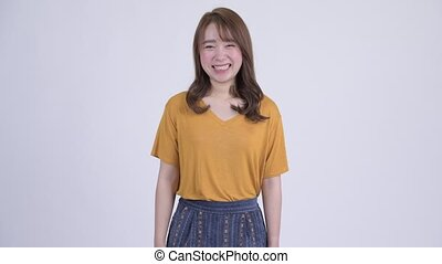 Happy young beautiful Asian woman smiling