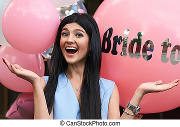 Happy young beautiful brunette bride to be with dark hair...