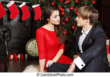 couple under Christmas tree