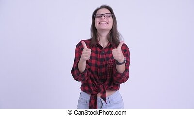 Happy young beautiful hipster woman giving thumbs up and...