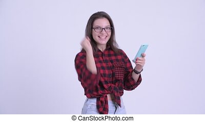 Happy young beautiful hipster woman using phone and getting...