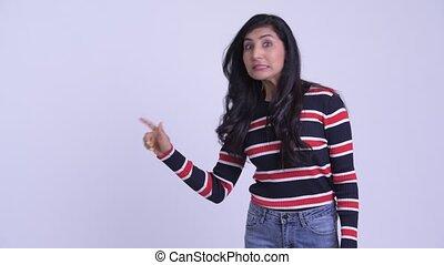 Happy young beautiful Persian woman touching something -...