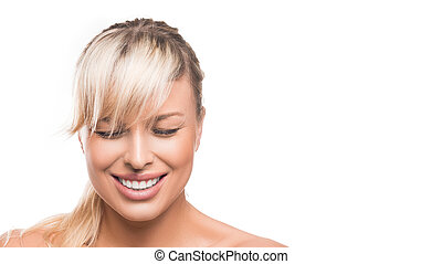 Happy young beautiful woman with closed eys laughing over white background.