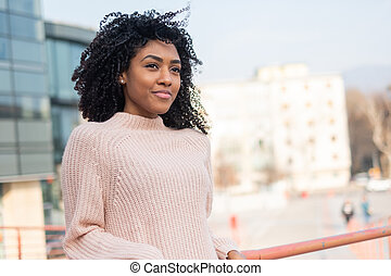 Happy young black girl smiling portrait outdoor