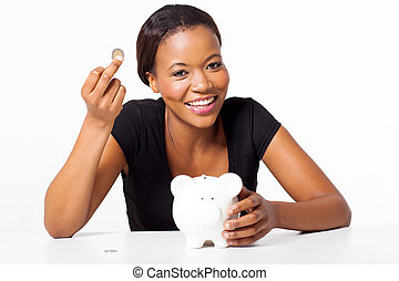 young black woman holding a coin