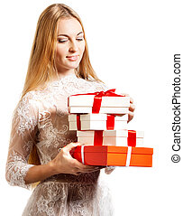Happy young blond girl with presents