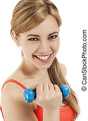 happy young blonde woman with a dumbbell on white background