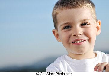 child - happy young boy child outdoor portrait