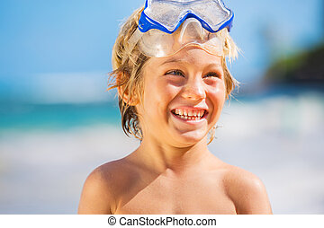 Happy Young boy having fun at the beach
