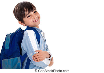 Happy young boy ready for school with his bag