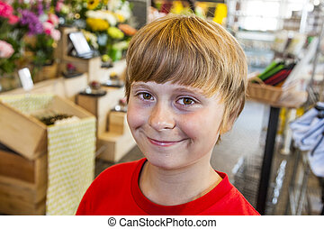 young boy smiles in a shop
