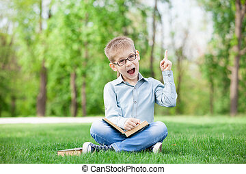 Happy young boy with a books