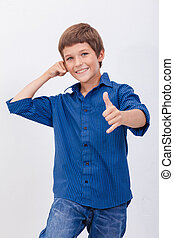 Happy young boy with calling gesture over white background