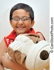 Happy Young Boy with his Soft Toy