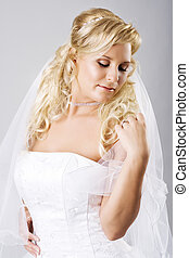 Happy young bride with veil