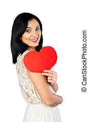 Happy young brunette with red Valentine heart isolated on white
