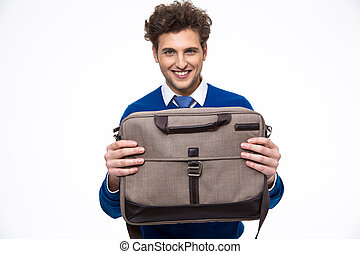 Happy young business man presenting laptop bag