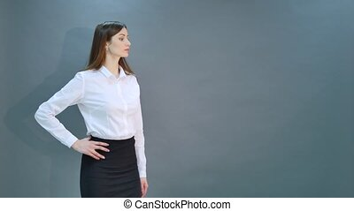 Happy young business woman isolated on black background