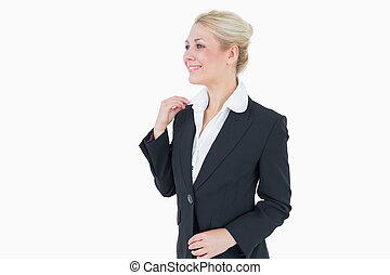 Happy young business woman looking away