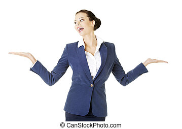 Happy young business woman showing copy space on her palm
