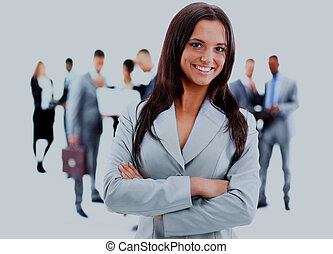 Happy young business woman standing in front of her team.