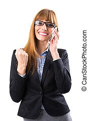 Happy young business woman with phone